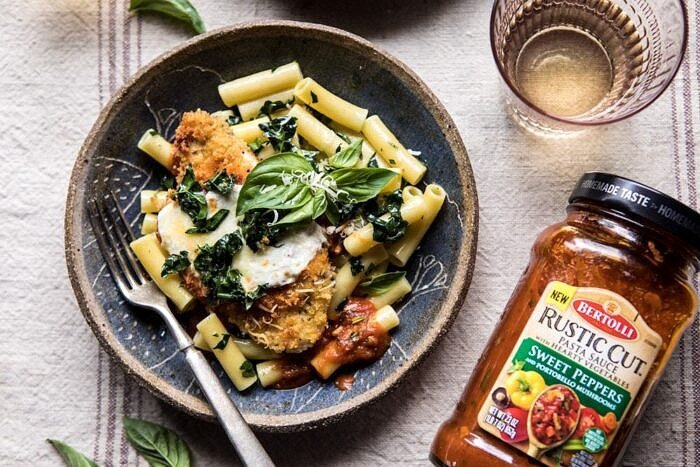 horizontal photo of Spring Chicken Parmesan with Tuscan Kale Pesto with pasta sauce