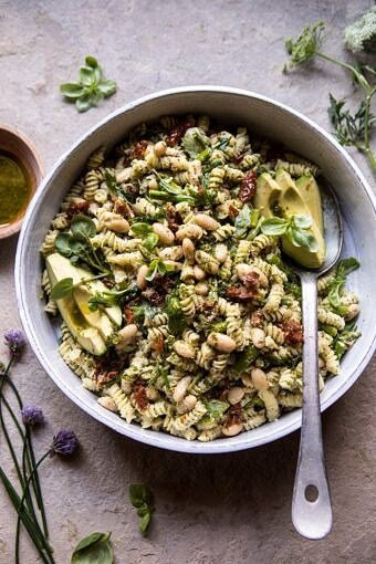 Sun Dried Tomato, White Bean, and Goat Cheese Pasta Salad | halfbakedharvest.com #quick #healthy #easyrecipes #salad