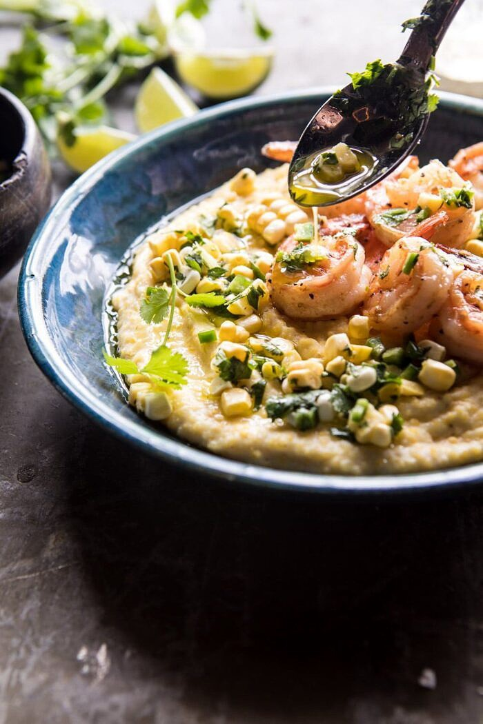 drizzling side angle photo of Sweet Corn Chimichurri Butter Shrimp with Polenta