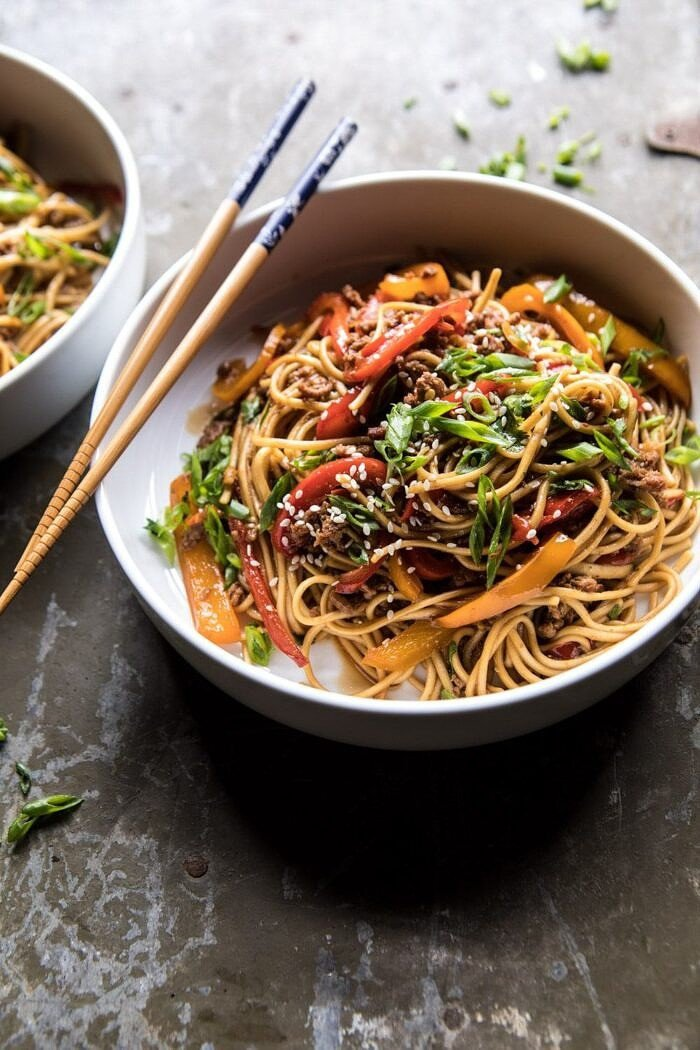 angled photo of Weeknight 20 Minute Spicy Udon Noodles with chopsticks