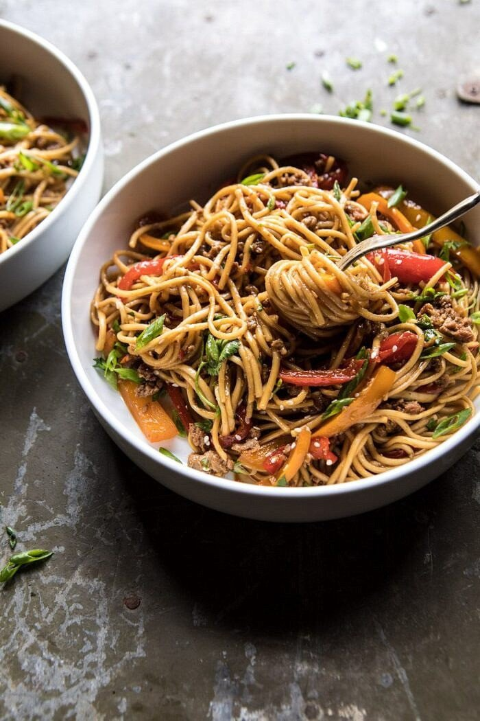 side angled photo of Weeknight 20 Minute Spicy Udon Noodles with fork