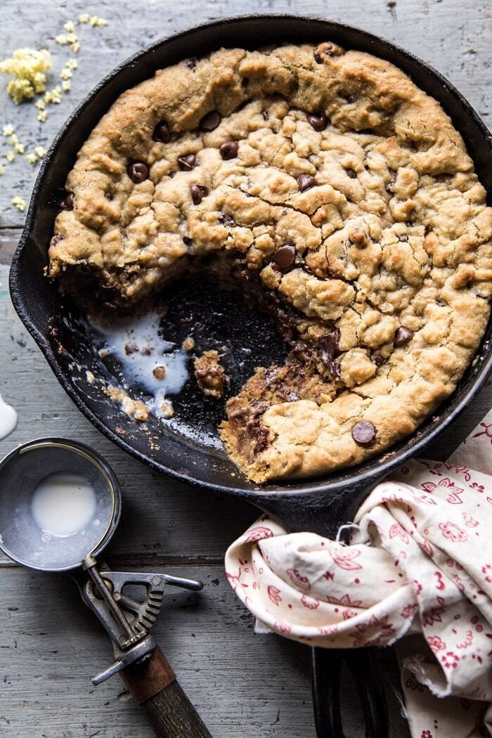 overhead photo of half eaten Whole Wheat Chocolate Chip Skillet Cookie