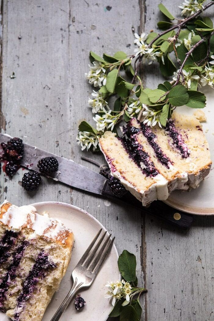 overhead photo of Blackberry Lavender Naked Cake with two cake pieces in photo