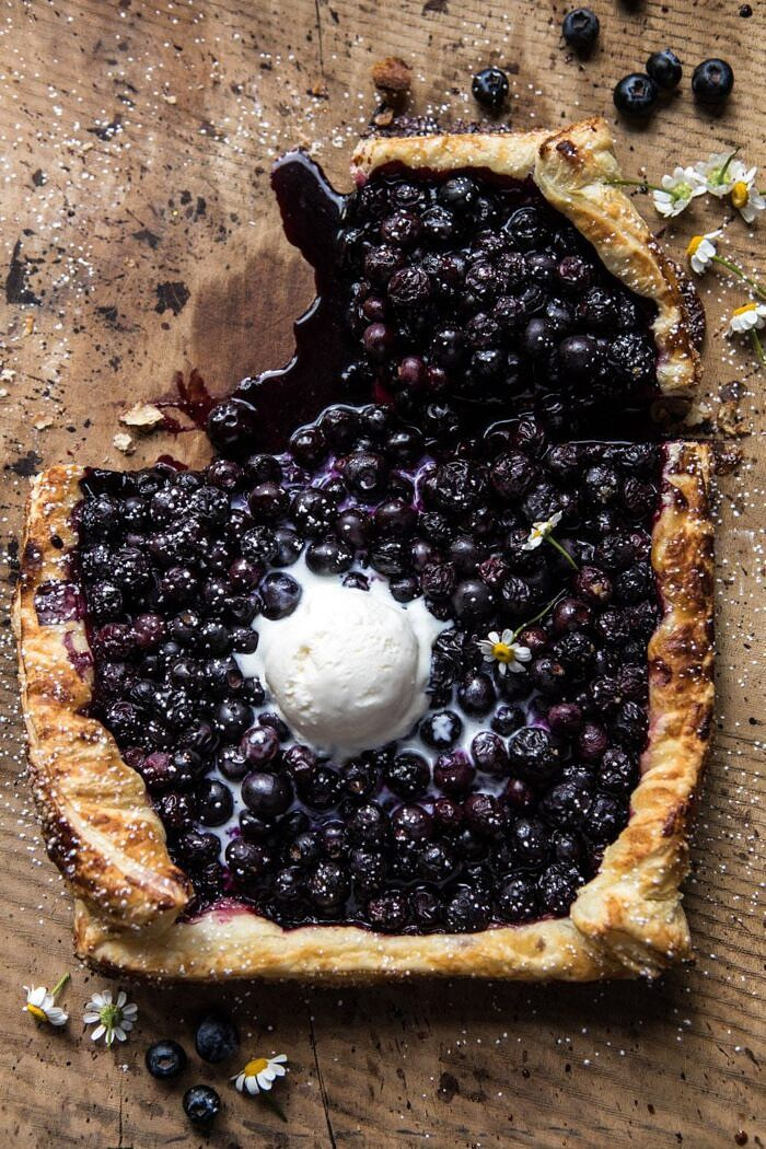 overhead photo of Blueberry Chamomile Galette with piece missing