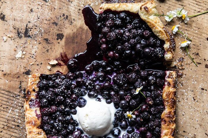 horizontal overhead photo of Blueberry Chamomile Galette with slice missing