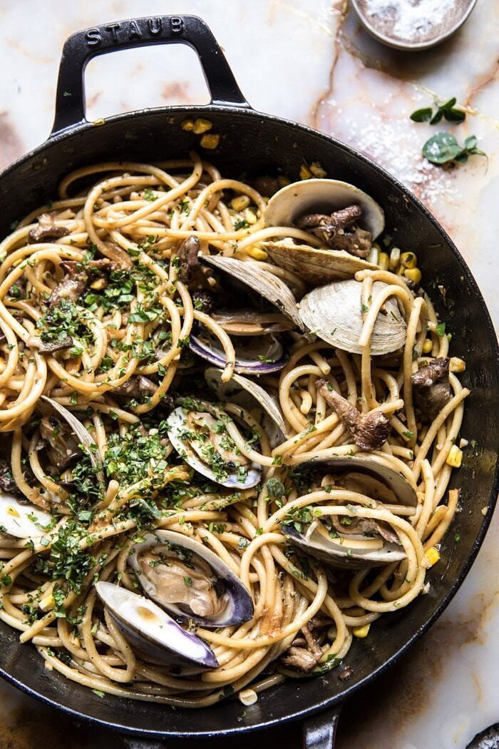 overhead photo of Buttery Mushroom and Clam Pasta in skillet