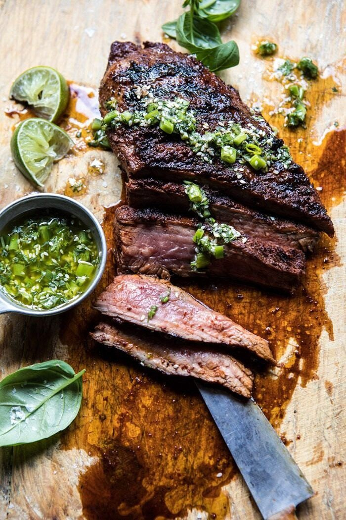 overhead photo of Korean Grilled Steak with Toasted Sesame Chimichurri with slices of steak missing