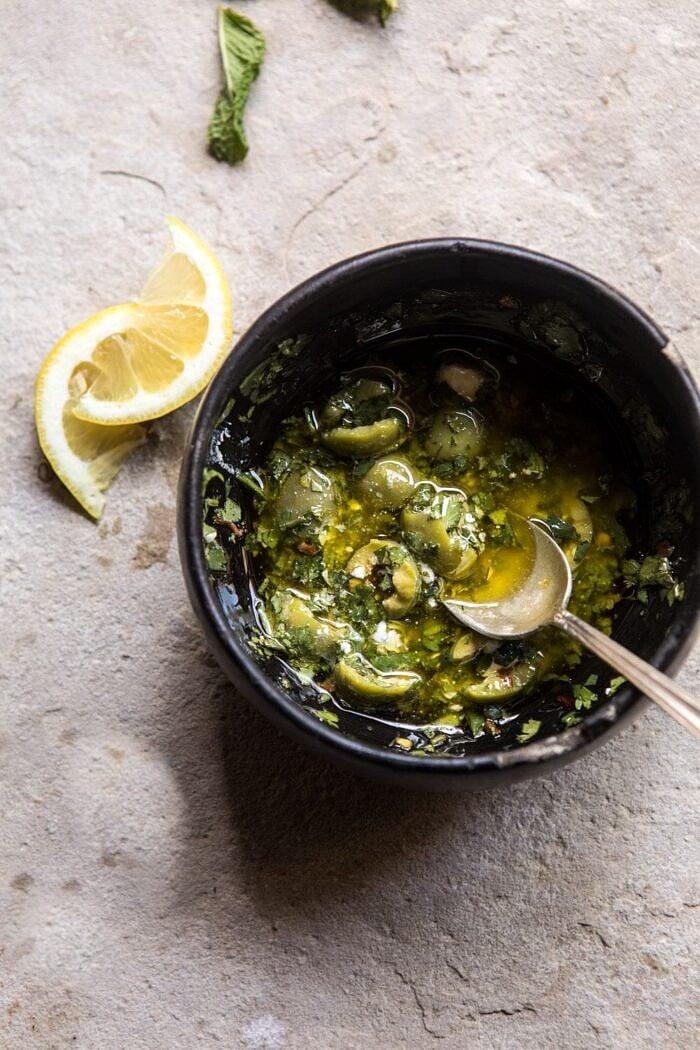 overhead photo of Herby Lemon Olive Vinaigrette