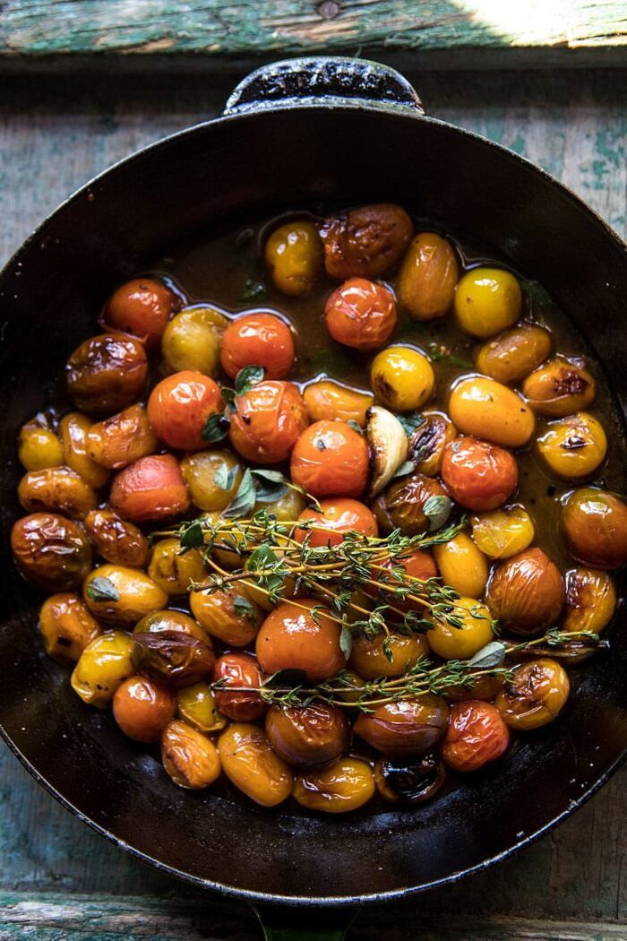 overhead photo of burst cherry tomatoes in skillet