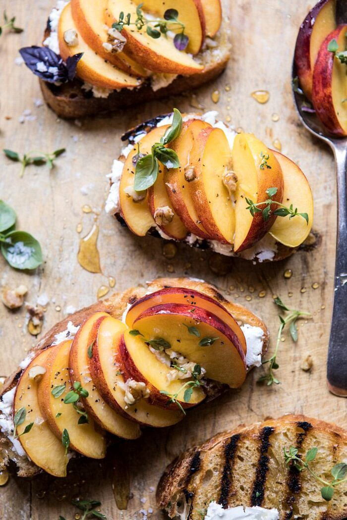 overhead close up photo of Thyme, Honey, Peach, and Goat Cheese Crostini