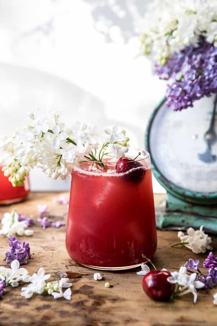 front on, close up photo Hibiscus Cherry Vodka Spritz with lilacs