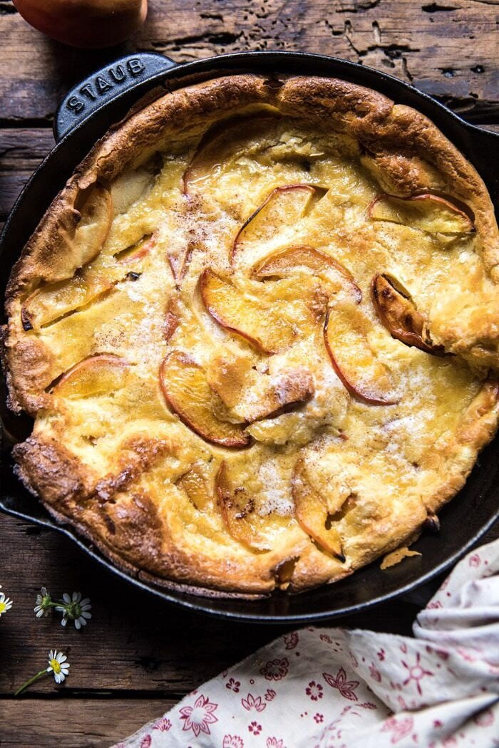 overhead close up photo of Browned Butter Cinnamon Peach Dutch Baby