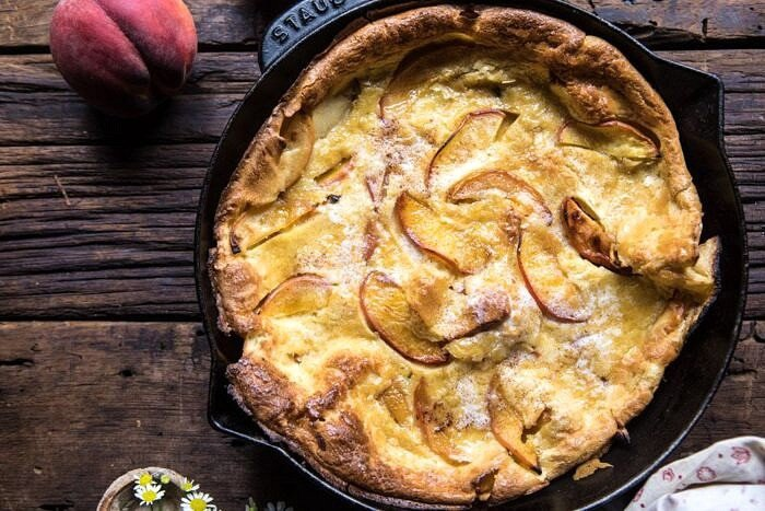 overhead horizontal photo of Browned Butter Cinnamon Peach Dutch Baby