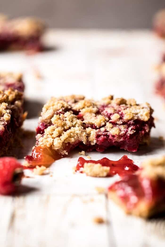 Buttery Raspberry Crumble Bars broken in half to show the filling