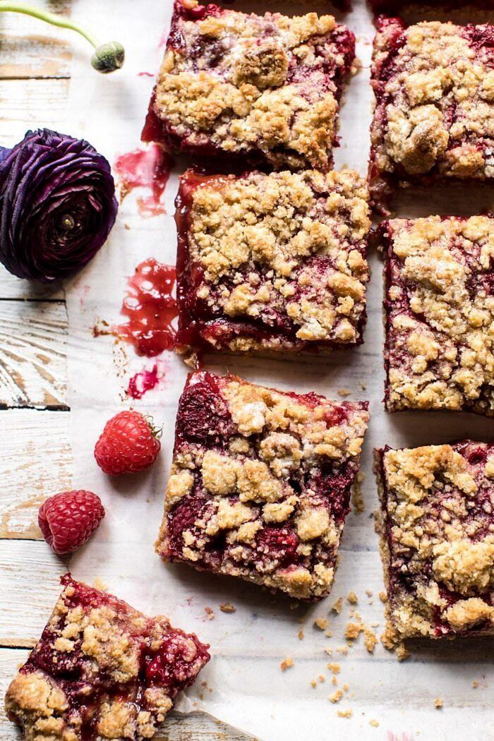 overhead photo of Buttery Raspberry Crumble Bars with bars cuts into squares