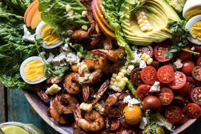 horizontal photo of Chipotle Shrimp Cobb Salad with Jalapeno Corn Vinaigrette