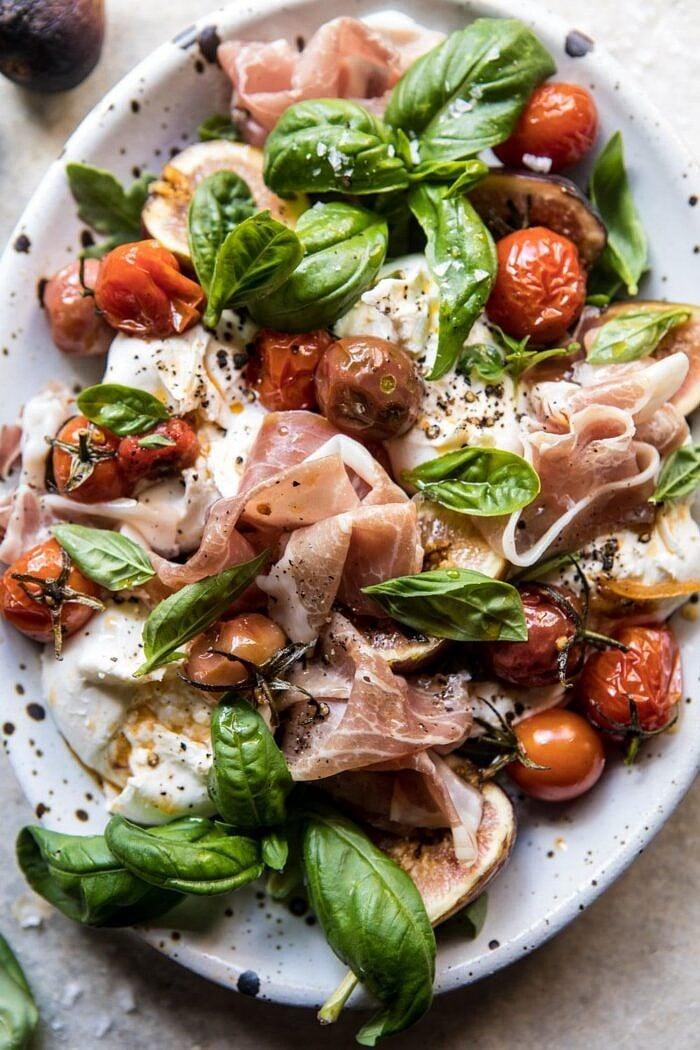 close up overhead photo of Fresh Fig, Prosciutto, and Arugula Salad with Cherry Tomato Vinaigrette