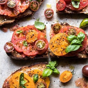 Heirloom Tomato, Basil, and Manchego Toast | halfbakedharvest.com #tomatoes #basil #easyrecipes #summerrecipes