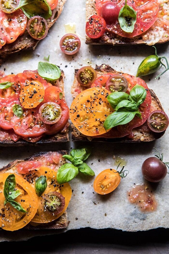 close up photo of Heirloom Tomato, Basil, and Manchego Toast