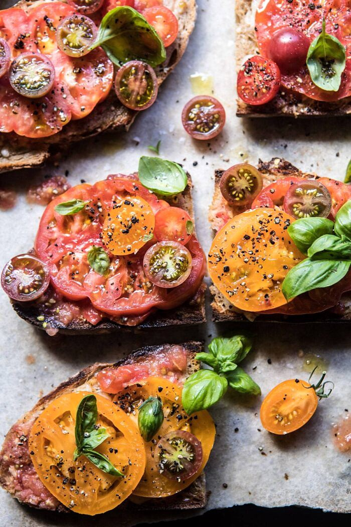 close up overhead photo of Heirloom Tomato, Basil, and Manchego Toast
