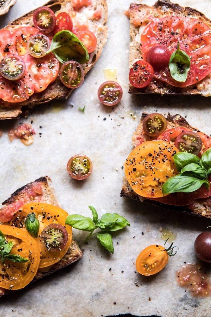 overhead photo of Heirloom Tomato, Basil, and Manchego Toast