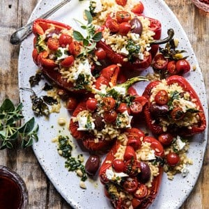 Greek Orzo Stuffed Red Peppers with Lemony Basil Tomatoes.