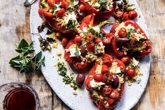 overhead horizontal photo of Greek Orzo Stuffed Red Peppers with Lemony Basil Tomatoes