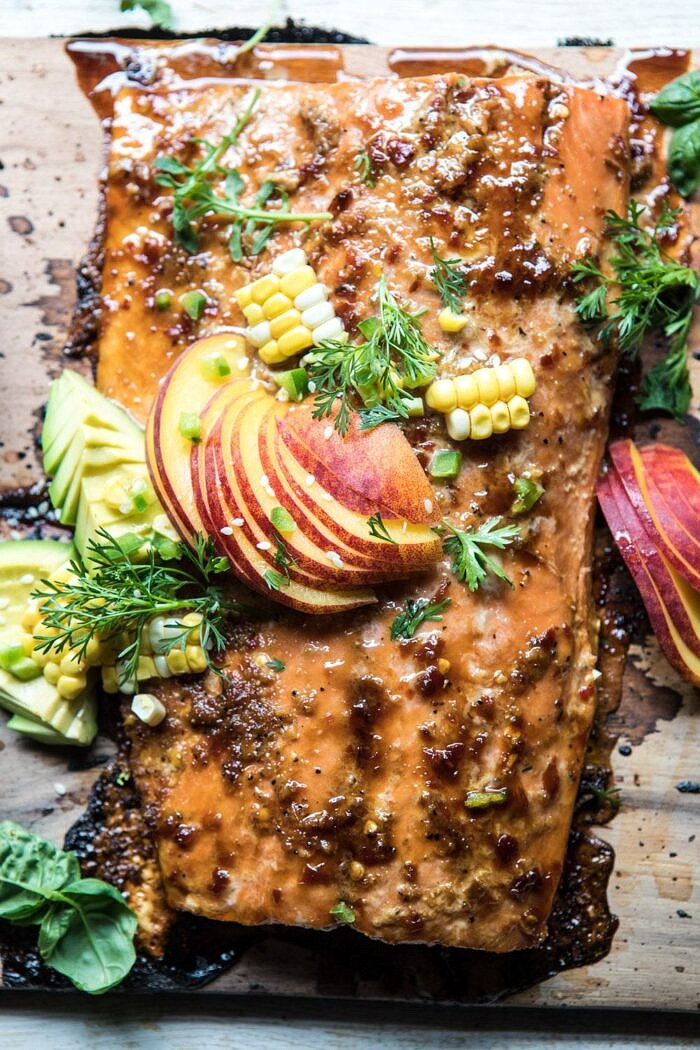 overhead close up photo of Honey Ginger Cedar Plank Grilled Salmon with Avocado Salsa