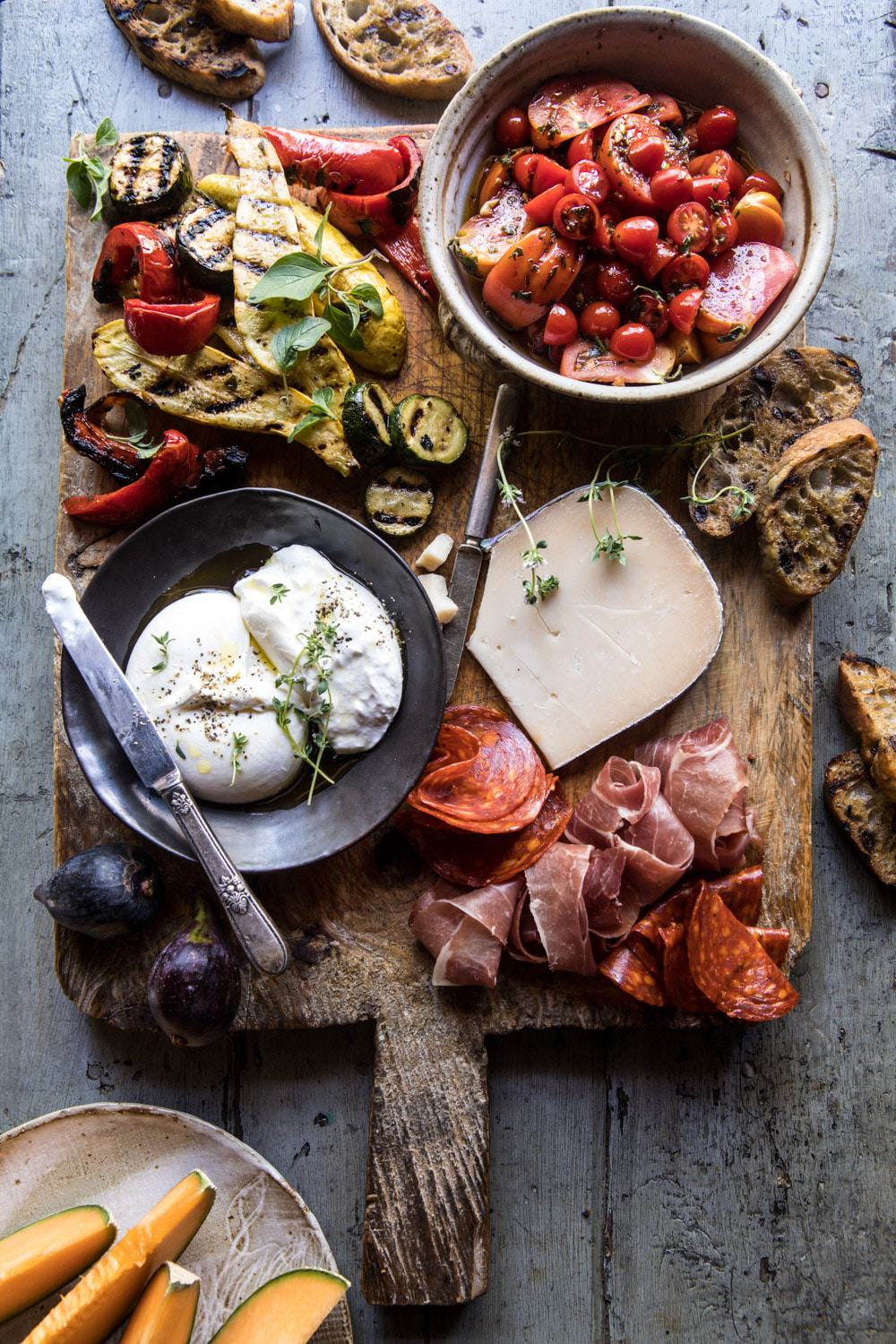 Marinated Tomato and Grilled Veggie Cheese Board | halfbakedharvest.com #cheeseboard #summerrecipes #easy #4thofjulyrecipe