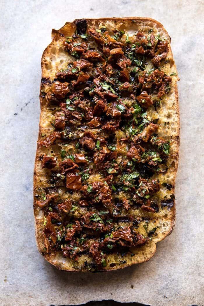 overhead photo of toasted ciabatta bread with Sun-Dried Tomato Pesto