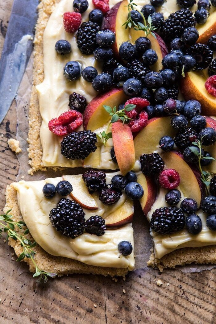 closer up overhead photo of No Bake Mixed Berry Custard Tart with piece cut out
