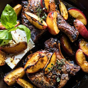 Skillet Balsamic Peach Pork Chops with Feta and Basil | halfbakedharvest.com #peaches #porkchops #easydinner #skilletrecipe