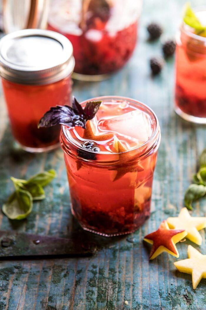 Smashed Berry Rose Spritz | halfbakedharvest.com #cocktails #4thofjulyrecipe #summerrecipes #easy