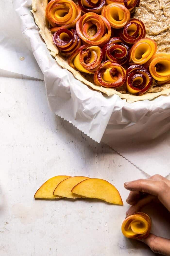 rolling peach slices into roses, overhead prep photo
