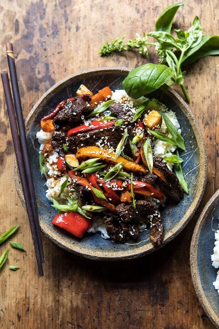 overhead photo of 30 Minute Korean Beef and Peppers with Sesame Rice and chopsticks on side of bowl
