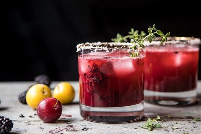 horizontal front on photo if Blackberry Thyme Margarita with plums in photo