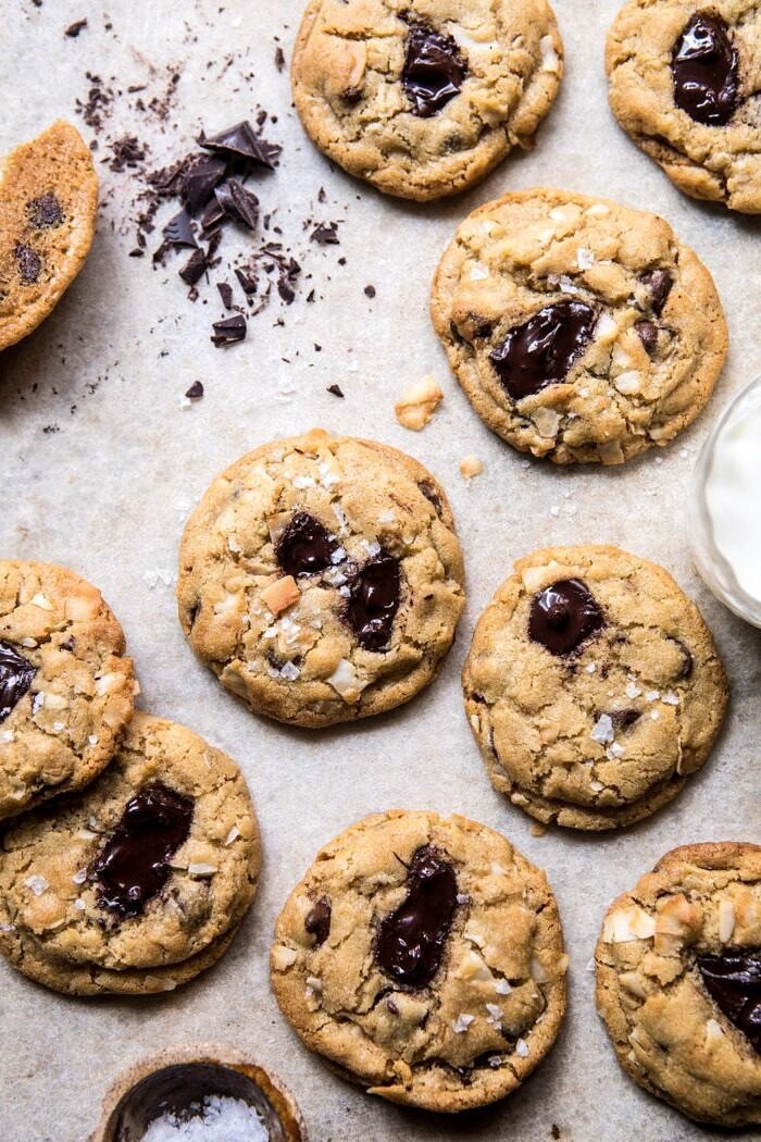 overhead photo of Browned Butter Coconut Chocolate Chip Cookies with milk in photo