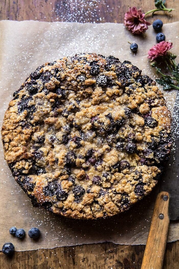 overhead photo of Bursting Blueberry Cardamom Buckle before being cut into