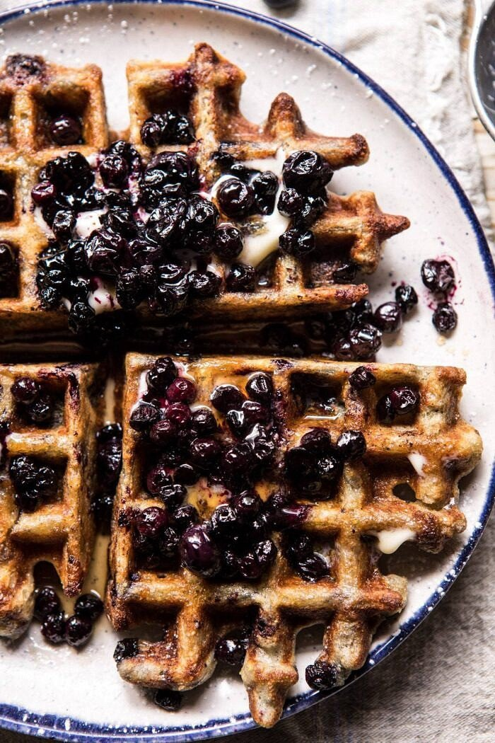 overhead close up photo of Bursting Blueberry Cornmeal Waffles