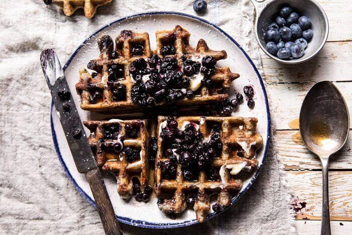 horizontal photo of Bursting Blueberry Cornmeal Waffles
