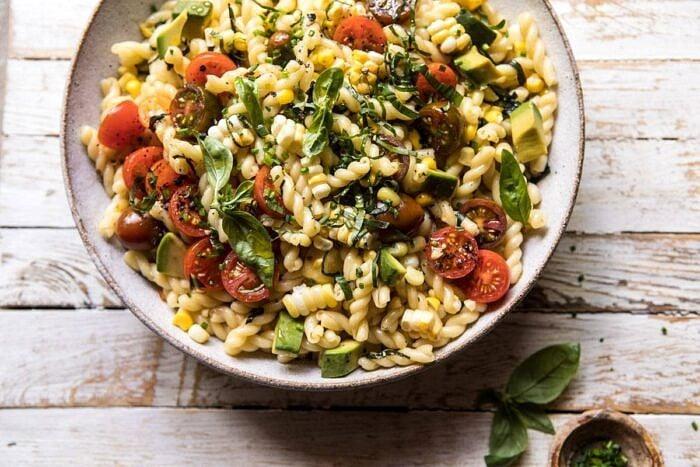 horizontal overhead photo of Corn, Tomato, and Avocado Pasta Salad
