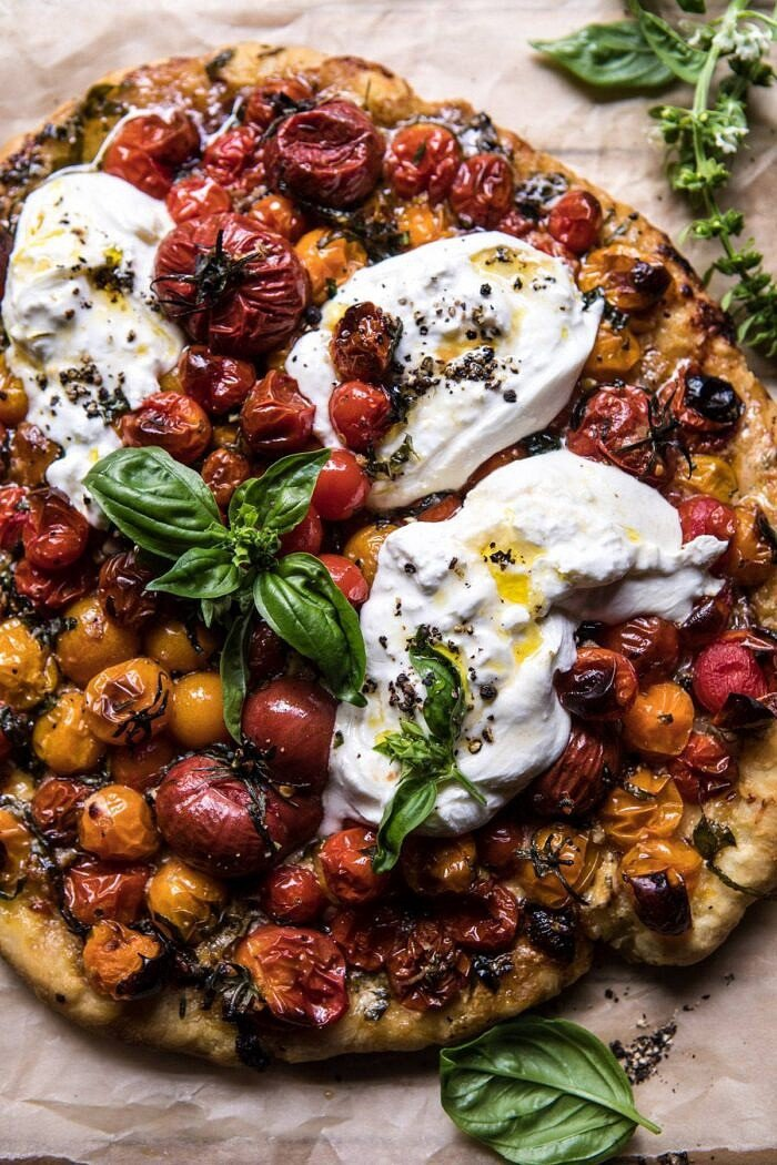 close up photo of Garlic and Herb Roasted Cherry Tomato Pizza with Caramelized Onions