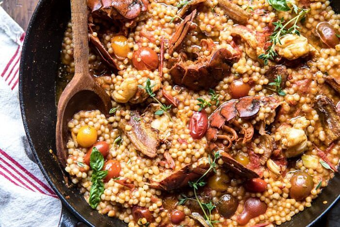 overhead horizontal photo of One Pot Tomato Basil Lobster and Herbed Pearl Couscous
