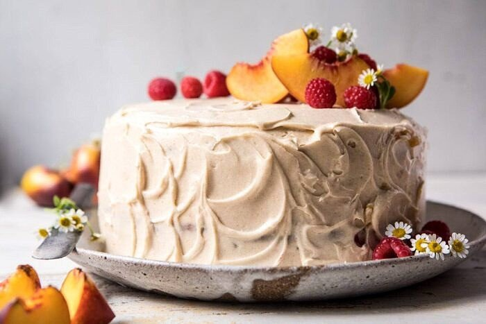 horizontal photo of Peach Ricotta Layer Cake with Browned Butter Buttercream
