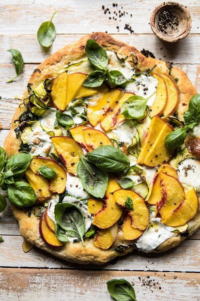 overhead photo of Pesto Zucchini and Peach Pizza with Burrata