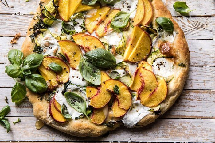 horizontal photo of Pesto Zucchini and Peach Pizza with Burrata