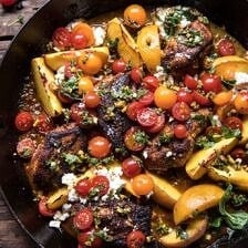 Skillet Moroccan Chicken with Tomatoes, Peaches, and Feta.