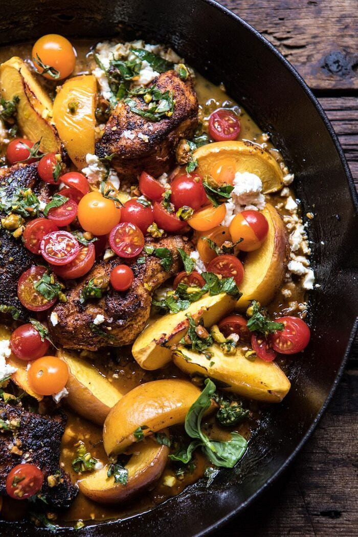 close up Skillet Moroccan Chicken with Tomatoes, Peaches, and Feta in skillet