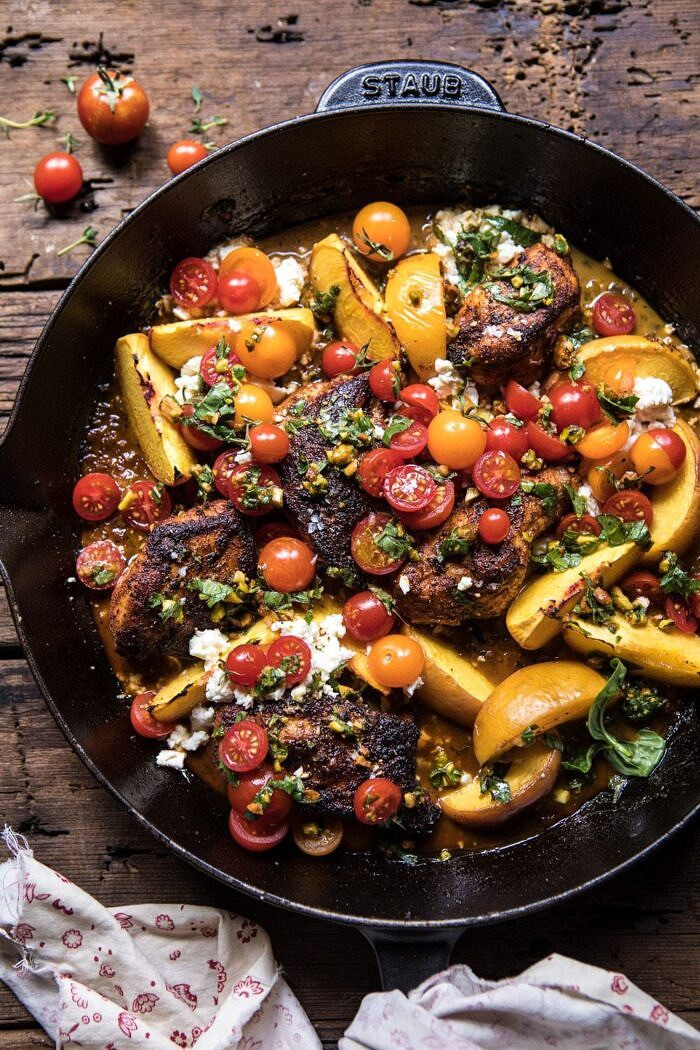 overhead photo of Skillet Moroccan Chicken with Tomatoes, Peaches, and Feta in skillet