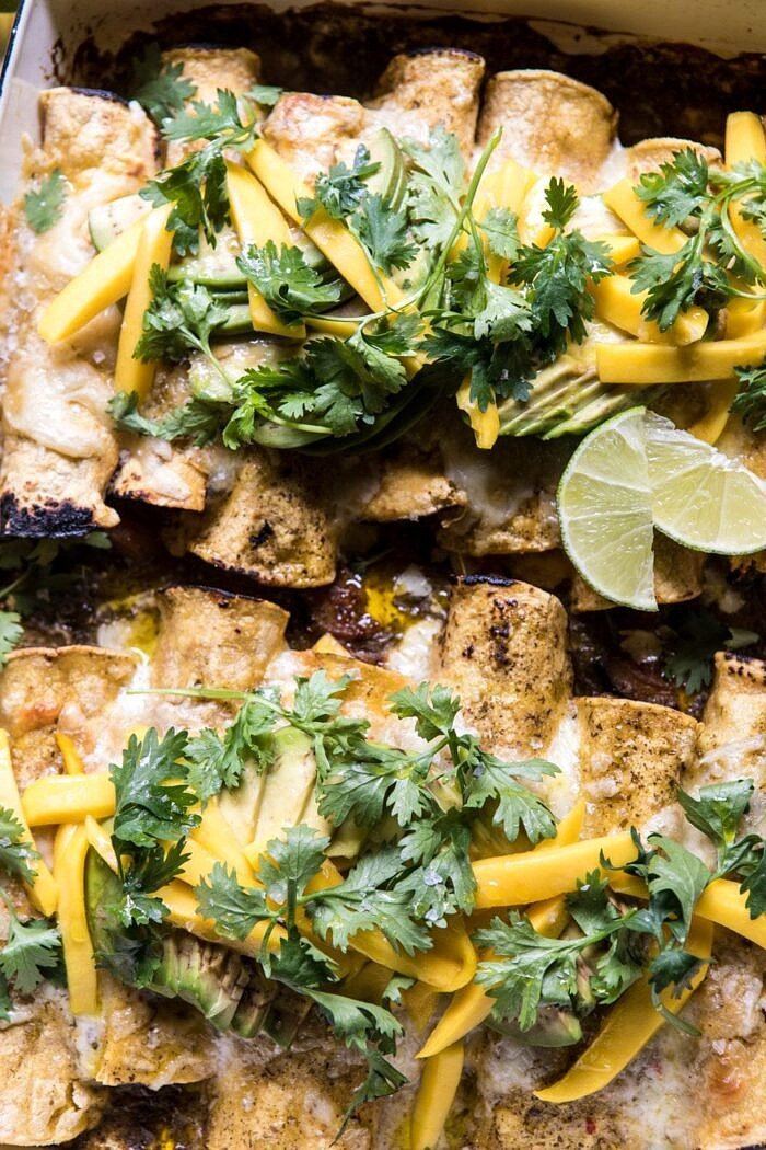overhead close up photo of Salsa Verde Chicken and Zucchini Enchiladas with Mango